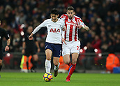 9th December 2017, Wembley Stadium, London England; EPL Premier League football, Tottenham Hotspur versus Stoke City; Son Heung-Min of Tottenham Hotspur on the ball with Geoff Cameron of Stoke City chasing