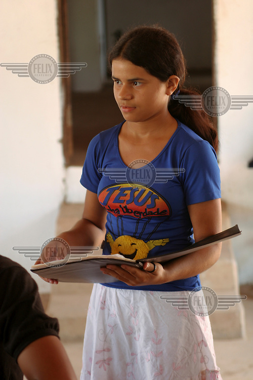 Student Gluciane Ferreira da Costa shows off her 'reality notebook' at the Escola Familia Agricola Antonio Fontenele (EFA) near Lago do Junco in Brazil's northeastern state of Maranhao. Students, many who come from far away, alternate living at the school and at home for 14 days at a time. The school is supported by the Association of Land Reform Settlements of Maranhao State (ASSEMA), an umbrella NGO of associations operated for and by rural peasants and Babacu nut breakers.