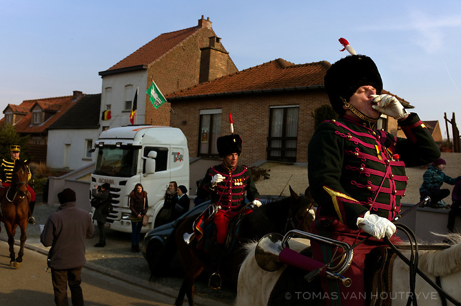 A participant on horseback drinks a shot during the Sint Veroon procession in Lembeek, Belgium on April 1, 2013. Participants dressed in 19th century Belgian military uniforms march along the language border every Easter Monday.