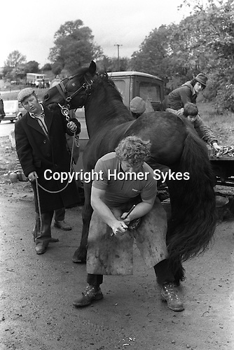 Appleby in Westmorland Horse fair Cumbria. 1981 Blacksmith shoeing a horse. 1981