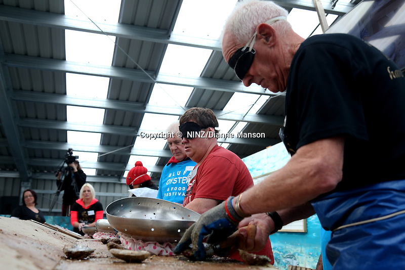 Shane Wixon (Ngai Tahu) left, and Keith Dawson (Barnes) shuck oysters blindfolded during the oyster opening competition at the Bluff Oyster and Food Festival, Bluff, New Zealand, Saturday, May 21, 2016. Credit:  Dianne Manson