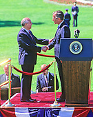 United States President George H.W. Bush, right, shakes hands with President Mikhail Gorbachev of the Union of Soviet Socialist Republics, left, during a state arrival ceremony on the South Lawn of the White House in Washington, DC on Thursday, May 31, 1990.  It was the start of three days of talks between the two leaders.<br /> Credit: Ron Sachs / CNP