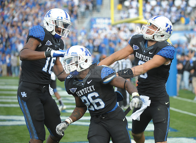 Kentucky Wildcats running back CoShik Williams (26) is congratulated after scoring the touchdown by wide receiver La'Rod King (16) and quarterback Matt Roark (3) during the second half of the University of Kentucky football game against Tennessee at Commonwealth Stadium in Lexington, Ky., on 11/26/11. Uk won the game 10-7. Photo by Mike Weaver   Staff
