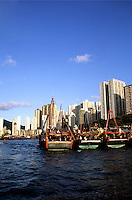 Boats and skycrappers on reclaimed land in Aberdeen Area of Hong Kong island where there used to be hindreds of thousands of people living on junks but now are in apartment