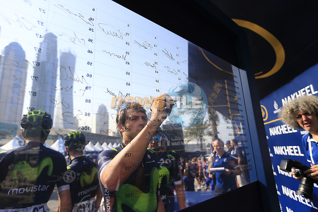 Alex Dowsett (GBR) Movistar Team signs on before the start of Stage 2, the Nakheel Stage, of the 2016 Dubai Tour starting at the Dubai International Marine Club and running 188km to Palm Jumeirah Atlantis, Dubai, United Arab Emirates. 4th February 2016.<br /> Picture: Eoin Clarke | Newsfile<br /> <br /> <br /> All photos usage must carry mandatory copyright credit (&copy; Newsfile | Eoin Clarke)