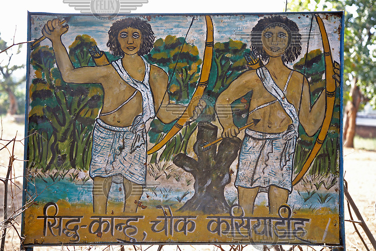 Painted memorial to two adivasi tribal brothers who died fighting the authorities of the British Raj and are considered symbols of resistance against the influx of mining companies to the area.  Lacking title deeds for land on which they have farmed and hunted for millennia, the rural adivasi communities are being displaced to make way for new industrial developments planned to capitalise on the land's mineral wealth.  Adivasi resistance to these developments often illicits a violent response from the authorities and subsequently many are joining the Naxalites, a revolutionary communist group from the Indian communist movement. .