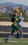 Bishop Manogue Miners Dontell Jackson (21) makes the catch for a touchdown against Arbor View Aggies in the first half of their NIAA 4A State Semi-Final football game played at McQueen High School on Saturday, Nov. 24,2018.