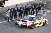 Jul. 4, 2008; Daytona Beach, FL, USA; Nascar Nationwide Series driver Dale Earnhardt Jr is greeted by his crew prior to the Winn-Dixie 250 at Daytona International Speedway. Mandatory Credit: Mark J. Rebilas-