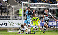 Rowan Liburd (Loanee from Reading) of Wycombe Wanderers beats a Curtis Thompson of Notts County tackle during the Sky Bet League 2 match between Notts County and Wycombe Wanderers at Meadow Lane, Nottingham, England on 28 March 2016. Photo by Andy Rowland.