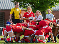 Referee Sara Cox with scrum halves Justine Pelletier and Lucy Nye at a scrum, U20 England Women v U20 Canada Women at Trent College, Derby Road, Long Eaton, England, on 26th August 2016