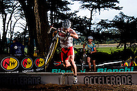 Team Specialized rider Joshua Rebol, center, leaps over a barrier in a category B men Bay Area Super Prestige cyclocross race in San Francisco's Golden Gate Park Sunday afternoon November 25, 2007. Rebol eventually finished 16th place, 3:08 behind winner Anthony Coando of team Altezza 40.