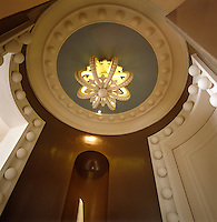 The domed ceiling of this small circular hallway has been decorated in the same fashion as the door frames