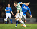 St Johnstone v Celtic.....26.12.13   SPFL<br /> Gary McDonald gets a whack from Anthony Stokes<br /> Picture by Graeme Hart.<br /> Copyright Perthshire Picture Agency<br /> Tel: 01738 623350  Mobile: 07990 594431