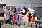 Jimmy Deenihan presented prizes to the Art competition winners Pictured Front left to right, Eoin Walsh, Muireann O'Brien, Aine Walsh.  Back left to right, Michelle Burke, Grace Tobin, Peter Tobin, Jimmy Deenihan, Marguerite O'Halloran, Rosebud the Dog, Dermot Crowley, Ellen Lenihan at  the Spa/Churchill Fenit Annual Heritage Weekend at the Forge Churchill on Saturday