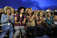 Rodeo fans, Hannah Robertson, Briana Scott, Leah Robertson, Mika Boday and Patty Boday, all of Maui, Hi cheer during the bull riding event at the 4th of July Makawao Rodeo which is held annually at the Oskie Rice Arena in Olinda, upcountry Maui. The rodeo is the largest rodeo in Hawaii, typically attracting more then 4000 spectators.