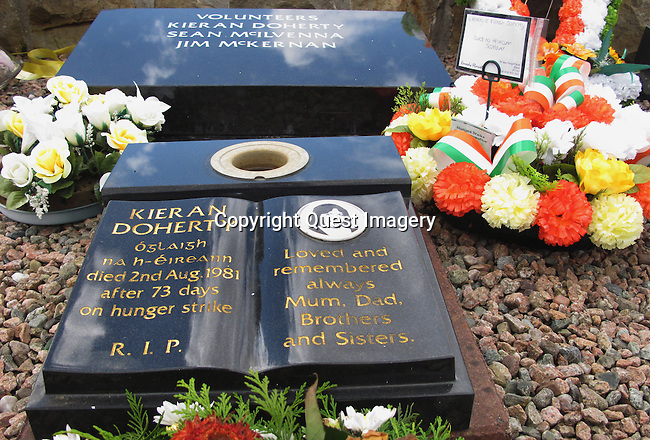 The burial plot of Kieran Doherty one of the ten hunger strikers who died in 1981 in the H. Blocks in the 'New' Republican plot at Milltown Cemetery in Belfast, Northern Ireland.  <br /> <br /> Milltown Cemetery is a famous landmark the world over due to the Republican graves in the 'New' Republican plot contained within it most notable being that of Bobby Sands, the  <br /> <br /> Milltown is an established landmark of Nationalist Belfast, is often identified outside the realms of normal everyday burials, with the conflict of the past thirty years. Being the main Catholic burying ground for the city it is intertwined into the legacy of conflict. <br /> Photo by Deirdre Hamill/Quest Imagery
