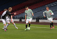 Ross Millen (2) and Scott Gray watch Callum McGregor with John Herron overlapping  in the Dunfermline Athletic v Celtic Scottish Football Association Youth Cup Final match played at Hampden Park, Glasgow on 1.5.13. .