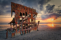 Peter Iredale's wreck on the beach near Warrenton, Oregon at sunset