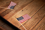 August 11, 2012. Ashland, VA.. Flags sit on a table in Homeades by Suzanne, a local restaurant where the Romney/ Ryan campaign planned to make a stop..  Republican presidential candidate Mitt Romney campaigned through Virginia and North Carolina over the weekend, showing off his new vice presidential pick Paul Ryan. The candidates stopped at several small businesses highlighting their promise to champion the needs of business owners across the country.