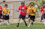 Los Angeles, CA 02/15/14 - Daniel Maxwell (Utah #10) and Gil Cassagne (USC #23) in action during the Utah versus USC game as part of the 2014 Pac-12 Shootout at UCLA.  Utah defeated USC 10-9.