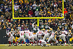 New York Giants kicker Lawrence Tynes (9) kicks an extra point at the end of the first half during an NFL divisional playoff football game against the Green Bay Packers on January 15, 2012 in Green Bay, Wisconsin. The Giants won 37-20. (AP Photo/David Stluka)