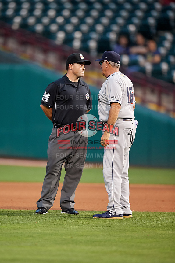 Colorado Springs Sky Sox manager Rick Sweet (16) talks with umpire Mike Cascioppo during a game against the Oklahoma City Dodgers on June 2, 2017 at Chickasaw Bricktown Ballpark in Oklahoma City, Oklahoma.  Colorado Springs defeated Oklahoma City 1-0 in ten innings.  (Mike Janes/Four Seam Images)