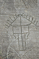 Petroglyph, rock carving, depicting a two storey house built on poles . Carved by the ancient Camunni people in the iron age between 1000-1600 BC. Rock no 24,  Foppi di Nadro, Riserva Naturale Incisioni Rupestri di Ceto, Cimbergo e Paspardo, Capo di Ponti, Valcamonica (Val Camonica), Lombardy plain, Italy