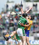 Declan Hannon of Limerick in action against John Conlon of Clare during their Munster Championship semi-final at Thurles.  Photograph by John Kelly.
