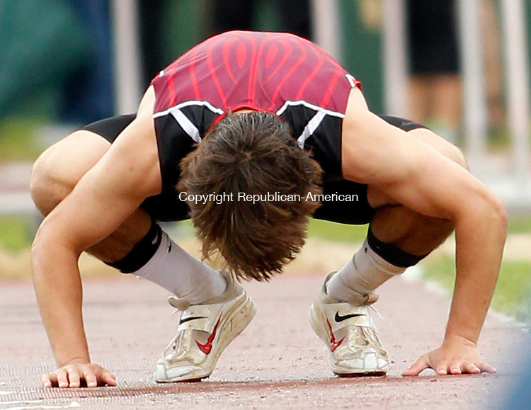 New Britain, CT-04 June 2012-060412CM05-  Cheshire's Jake Scinto streches out before the start of the triple jump during the State Open Track and Field Championships Monday afternoon at Willow Brook Park in New Britain.  Scinto was a three time winner on the day, winning the long, triple and high jump events.     Christopher Massa Republican-American