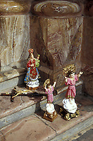 Catholic religious statuettes on the steps of the cathedral in Cuenca, Ecuador