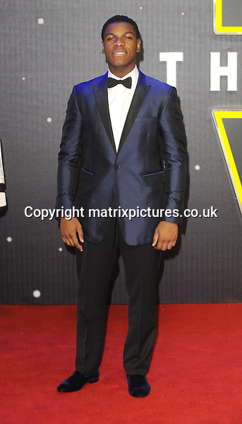 NON EXCLUSIVE PICTURE: PAUL TREADWAY / MATRIXPICTURES.CO.UK<br /> PLEASE CREDIT ALL USES<br /> <br /> WORLD RIGHTS<br /> <br /> English actor John Boyega attending the European Premiere of Star Wars: The Force Awakens in Leicester Square, in London.<br /> <br /> DECEMBER 16th 2015<br /> <br /> REF: PTY 153700
