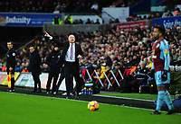 Burnley manager Sean Dyche shouts instructions to Aaron Lennon team from the dug-out <br /> <br /> Photographer Ashley Crowden/CameraSport<br /> <br /> The Premier League - Swansea City v Burnley - Saturday 10th February 2018 - Liberty Stadium - Swansea<br /> <br /> World Copyright &copy; 2018 CameraSport. All rights reserved. 43 Linden Ave. Countesthorpe. Leicester. England. LE8 5PG - Tel: +44 (0) 116 277 4147 - admin@camerasport.com - www.camerasport.com