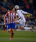 Atletico Madrid's Uruguayan midfielder Cristian Rodriguez vies with Real Madrid's defender Daniel Carvajal during the Spanish Copa del Rey (King's Cup) semifinal second-leg football match Club Atletico de Madrid vs Real Madrid CF at the Vicente Calderon stadium in Madrid on February 11, 2014.   PHOTOCALL3000/ DP