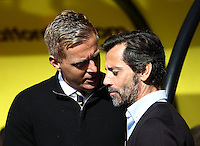 Garry Monk manager of Swansea and Quique Flores manager of Watford   during the Barclays Premier League match Watford and Swansea   played at Vicarage Road Stadium , Watford
