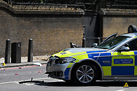 04 August 2018 London<br /> In the early hours of Saturday morning, c. 430 am, police were in pursuit of a moped, with two riders, in Grosvenor Place which runs along the west side of Buckingham Palace.  <br /> The bike crashed and one of the riders was arrested and taken to hospital with suspected broken legs.  The other escaped on foot and police are still searching for him.<br /> One police car crashed and rolled over. Both officers were bruised, dazed and shaken but both got out of the car with no serious injuries.  The driver was an experienced driver from Kensington &amp; Chelsea police station.  Another police car was also involved.<br /> The road remains closed while scene of crime officers examine the scene.<br /> London England on August 04, 2018<br /> *Exclusive* Special rates apply<br /> CAP/HAR<br /> &copy;HAR/Capital Pictures