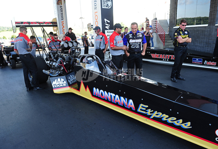 Jun. 15, 2012; Bristol, TN, USA: NHRA crew members for top fuel dragster driver Steve Torrence during qualifying for the Thunder Valley Nationals at Bristol Dragway. Mandatory Credit: Mark J. Rebilas-