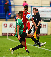 Lincoln City's James Hugo lifts the ball over Gainsborough Trinity's Jordan Richard<br /> <br /> Photographer Andrew Vaughan/CameraSport<br /> <br /> Pre-Season Friendly - Gainsborough Trinity v Lincoln City - Saturday 15th July 2017 - The Gainsborough Martin &amp; Co Arena - Gainsborough<br /> <br /> World Copyright &copy; 2017 CameraSport. All rights reserved. 43 Linden Ave. Countesthorpe. Leicester. England. LE8 5PG - Tel: +44 (0) 116 277 4147 - admin@camerasport.com - www.camerasport.com