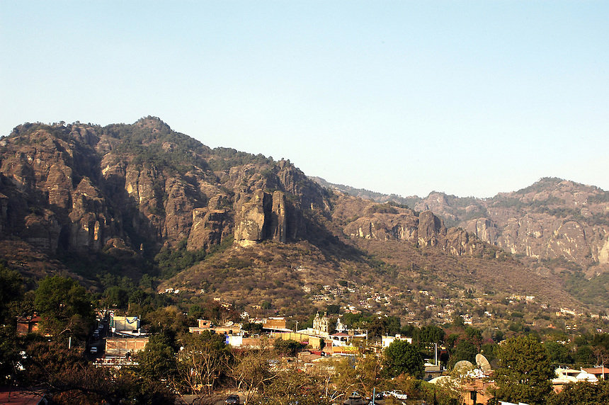 The village of Tepotzlan, Morelos nestled at the foot of the dramatic Tepozteco mountains. Mexico 02-06
