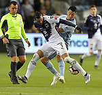 Rogelio Funes Mori (L) of of C.F Monterrey vies for the ball with Roger Espinoza of Sporting KC during their CONCACAF Champions League semifinal soccer game on April 11, 2019 at Children's Mercy Park in Kansas City, Kansas.  Photo by TIM VIZER/AFP