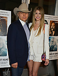 """a_Dwight Yoakam, Emily Joyce 042 attends the Premiere Of Sony Pictures Classic's """"David Crosby: Remember My Name"""" at Linwood Dunn Theater on July 18, 2019 in Los Angeles, California."""
