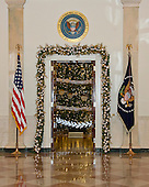 """The 2016 White House Christmas decorations are previewed for the press at the White House in Washington, DC on Tuesday, November 29, 2016. Pictured is the Grand Foyer looking towards the White House Christmas Tree in the Blue Room. The first lady's office released the following statement to describe those decorations, """"This year's holiday theme, 'The Gift of the Holidays,' reflects on not only the joy of giving and receiving, but also the true gifts of life, such as service, friends and family, education, and good health, as we celebrate the holiday season.""""<br /> Credit: Ron Sachs / CNP"""