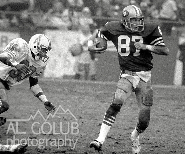 San Francisco 49ers vs. Houston Oilers at Candlestick Park Sunday, December 13. 1981.  49ers beat Oilers 28-6..San Francisco 49er Wide Receiver Dwight Clark (87) get away from Huston Oiler Defensive Back J.C. Wilson (33)..Photo By Al Golub/Golub Photography.