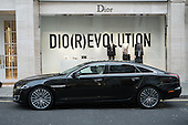 Chauffeur driven Jaguar waits outside Dior  luxury shop, Mayfair, London.