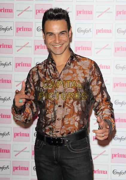 Chico Slimani.Comfort Prima High Street Fashion Awards held at the Battersea Evolution, Battersea, London, England..September 13th 2012.half length hands arms smiling fingers pointing brown white print shirt .CAP/ROS.©Steve Ross/Capital Pictures