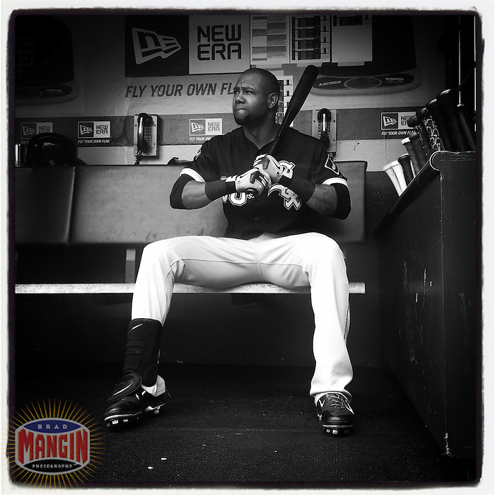 SAN FRANCISCO, CA - AUGUST 13: Instagram of Alejandro De Aza of the Chicago White Sox sitting in the dugout before a game against the San Francisco Giants at AT&T Park on August 13, 2014 in San Francisco, California. Photo by Brad Mangin