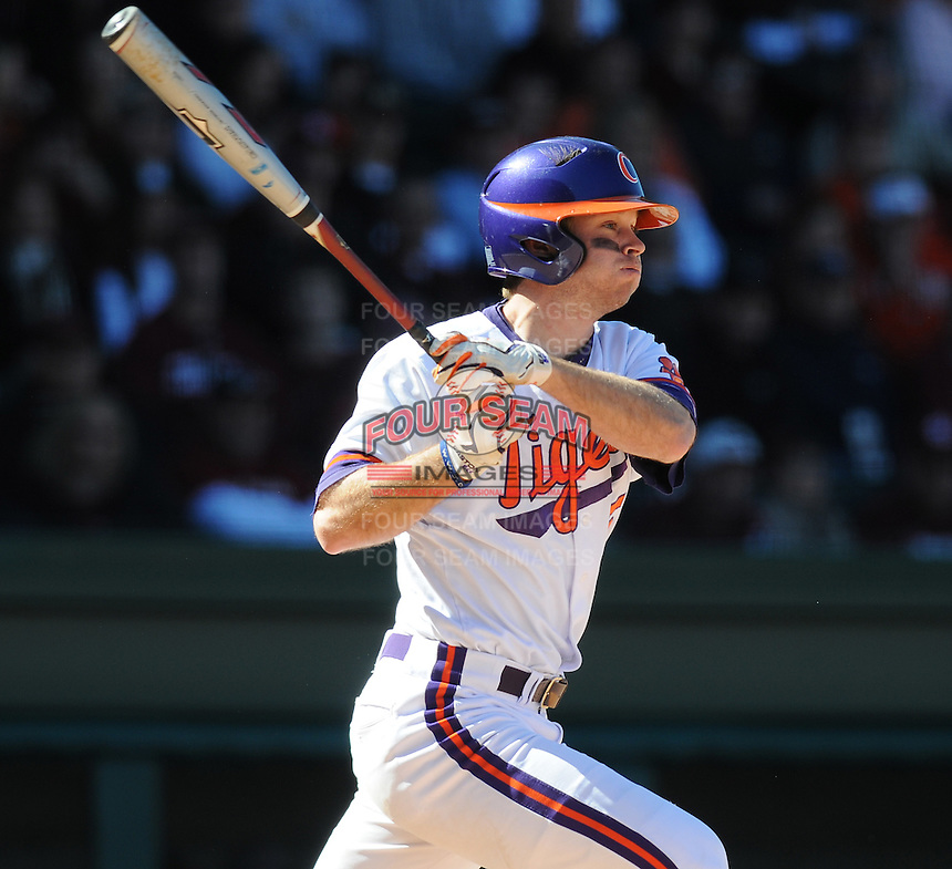 Clemson second baseman Mike Freeman (5) hits during a game between the Clemson Tigers and South Carolina Gamecocks Saturday, March 6, 2010, at Fluor Field at the West End in Greenville, S.C. Photo by: Tom Priddy/Four Seam Images