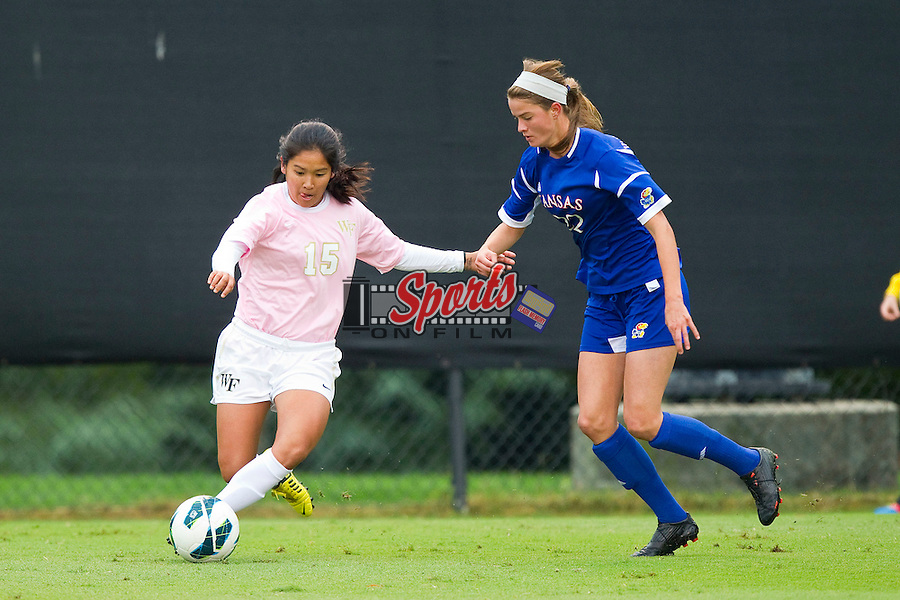 Marisa Park (15) of the Wake Forest Demon Deacons tries to keep the ball away from Caroline Van Slambrouck (22) of the Kansas Jayhawks at Spry Soccer Stadium on October 7, 2012 in Winston-Salem, North Carolina.  The Demon Deacons and the Jayhawks battled to a 1-1 tie in double overtime.  (Brian Westerholt/Sports On Film)