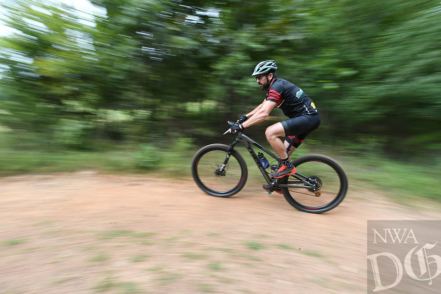 NWA Democrat-Gazette/J.T. WAMPLER  A competitor races down a trail Sunday August 11, 2019 during the Kessler Mountain Jam in Fayetteville. The annual event is sponsored by Fayetteville Parks and Recreation and is part of the Arkansas Mountain Bike Championship Series.