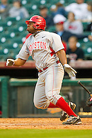 Jonathan Davis #40 of the Houston Cougars follows through on his swing against the Texas Tech Red Raiders at Minute Maid Park on March 4, 2012 in Houston, Texas.  The Red Raiders defeated the Cougars 10-4.  Brian Westerholt / Four Seam Images