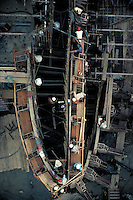 Aerial view of men on scaffolding, working to build the giant Tucurui dam on the Tocantins river, a tributary to the Amazon. Hydroelectric power, natural resources, construction. Para Brazil Tocantins river.